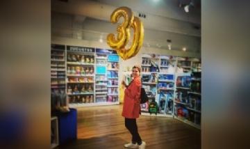 Mónica cumpliendo 30 en Madrid, España.